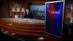 Wideshot of Melbourne's news studio, with Peter Mitchell presenting.