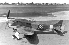The first production Tempest V JN729. Small blisters streamlining the aft upper wing attachment bolts are visible on the wing root fairing. Long-barrelled Hispano II cannon and Typhoon five-spoke mainwheels were other identifying features of the first production batch of 100 Tempests Vs.