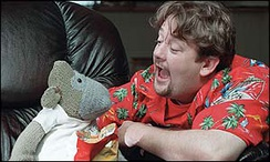 "Screenshot from one of ITV Digital's adverts, featuring Johnny Vegas and the ""ITV Digital Monkey"""