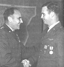 Presenting Distinguished Flying Cross to his son, Captain Michael E. Ryan (right), 1969.
