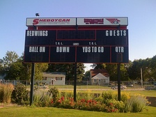 A scoreboard for American high school football, which also features tenths timing for track and field events.