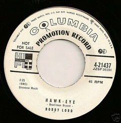 "Transitional 1955 promo 45 r.p.m. label showing both the old ""notes and mike"" and new ""walking eye"" logos"