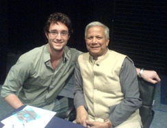 Yunus (right) at a book signing at the London School of Economics