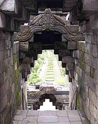 Interlocking andesite stone blocks forming a corbeling arch in Borobudur.