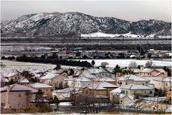 January snowfall in San Bernardino with Shandin Hills in the background. near Verdemont and the University District