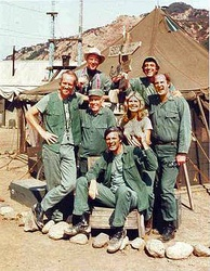 The cast of M*A*S*H from season 8 onwards (clockwise from left): Mike Farrell, William Christopher, Jamie Farr, David Ogden Stiers, Loretta Swit, Alan Alda, and Harry Morgan