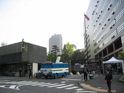 The main gate of the Embassy (photographed in 2004). Embassy building (right), Japanese police station (left).