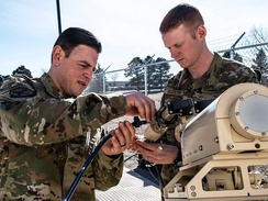 25th maintainers change a feed on a ground terminal antenna. Colorado Springs, CO January 24, 2020