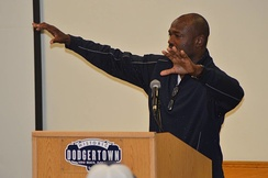 Harold Reynolds speaks to the athletes
