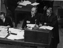 Sir David Maxwell Fyfe (at lectern, left) and an unknown prosecutor