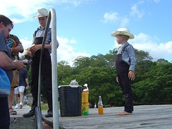 Children in an Old Order Mennonite community selling peanuts near Lamanai in Belize
