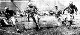 "Caddel (No. 1) in January 1936 with newspaper caption, ""Here's How Stellar Lion Halfback Makes those Long Gains"""