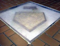 Forbes Fields' home plate lies encased and on display in the lobby floor of the University of Pittsburgh's Posvar Hall.