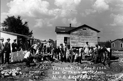 Students clear the ruins of the segregated Lee County Training School, a month after the 1936 tornado