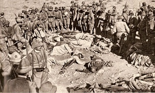 Italian soldiers watching corpses of dead Libyan and Turk defenders