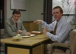 Hugh Laurie (right) breaking the fourth wall and addressing the TV viewers during a sketch with Stephen Fry
