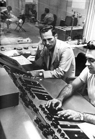 Atkins listening as Bill Porter adjusts a mix in RCA's Nashville studio