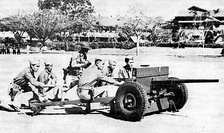 U.S. Army Philippine Scouts at Fort William McKinley, Philippine Islands firing a 37mm anti-tank gun in training.