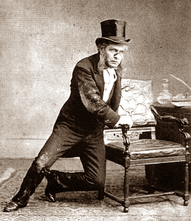 middle=aged man in Victorian evening dress, much muddied and torn, clutching a chair for support