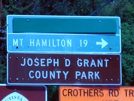 Directional signage to Joseph D. Grant County Park begins at the ascent of SR 130 to Mount Hamilton.