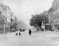 April 16, 1921 flood on Town Creek, a tributary of the Pearl River in Jackson. The photo is a view of East Capitol Street looking east from North Farish Street.