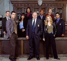 L–R, the cast of NYPD Blue at the beginning of season 11: Clapp, Gosselaar, Obradors, Beauvais-Nilon, Franz, Simmons, Ross, Brochtrup, Morales