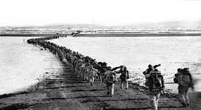 Chinese forces cross the Yalu River.