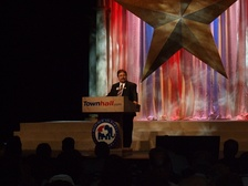 McKinney at the podium at the Texas Straw Poll.
