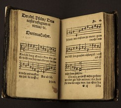 "Luther composed hymns and hymn tunes, including ""Ein feste Burg ist unser Gott"" (""A Mighty Fortress Is Our God"")"