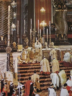 Papal Solemn Mass celebrated by Pope John XXIII in St. Peter's Basilica in the early 1960s. Note the presence of several assistant priests and ministers, and the mitre and the papal tiaras placed on the altar