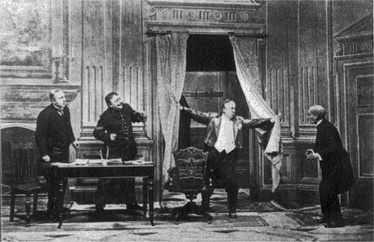 The magistrate arrives at his court: photograph of the 1917 musical version, called The Boy.