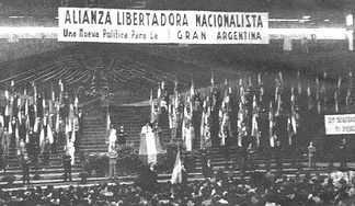 Congress of the Nationalist Liberation Alliance. The ALN symbol of the Andean condor clutching a hammer and a feather is on the background wall.