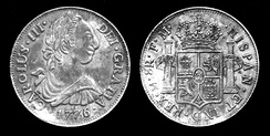 "Silver 8 real coin of Carlos III, dated 1776. The Latin inscription reads: (obverse) 1776 CAROLUS III DEI GRATIA, (reverse) HISPAN[IARUM] ET IND[IARUM] REX M[EXICO] 8 R[EALES] F M; in English, ""1776 Charles III, by the Grace of God, King of the Spains and of the Indies, Mexico [City Mint], 8 Reales.""  The reverse depicts the arms of Castile and León, with Granada in base and an inescutcheon of Anjou, supported by the Pillars of Hercules adorned with PLVS VLTRA motto."