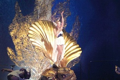 "Minogue emerging as ""Aphrodite"" at the Sydney Entertainment Centre."
