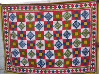 A quilt showing a regular tessellation pattern