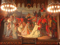 """Le Devouement des Bourgeois de Calais 1347"", ""The Devotion of the Burghers of Calais"". Philippa of Hainault begs King Edward III to spare the lives of the six volunteers for martyrdom. 19th-century mural in Council Chamber, Hôtel de Ville, Calais"