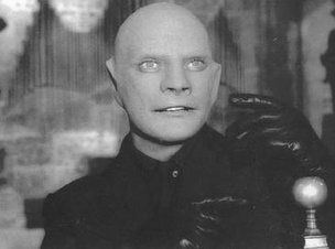 Jean Marais as Fantômas in the 1964 film. In addition to the characteristic face mask, the black gloves of Fantômas are visible.