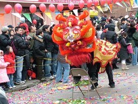 "Celebrating Chinese New Year in ""Little Fuzhou"", one of several Chinatowns in Brooklyn, in Sunset Park. Brooklyn's rapidly growing Chinese American population was estimated to have surpassed 200,000 in 2014.[61]"