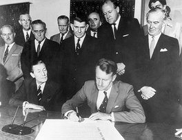 Ian Smith signs the Unilateral Declaration of Independence.