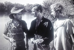 This location shot with actors (left to right) Naish, Scott, and Lloyd illustrates Androit's use of early- and late-day sunlight to maintain stark shadowing effects.