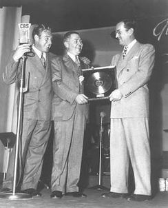 "First gold record award for ""Chattanooga Choo Choo"" is presented to Glenn Miller by W. Wallace Early of RCA Victor with announcer Paul Douglas on far left, February 10, 1942."