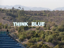 Think Blue sign in the mountains north of Dodger Stadium, an homage to the nearby Hollywood Sign.