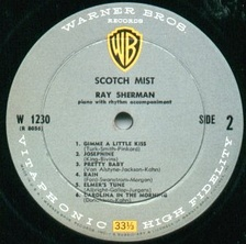 The grey, black, white and yellow label design used for Warner Bros. mono albums from 1958 to 1964 when it switched to the same gold label as the stereo version.