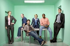 The cast of Psych, from left to right: Maggie Lawson, Corbin Bernsen, James Roday, Kirsten Nelson, Dulé Hill, and Timothy Omundson