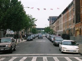 Puerto Rican flags fly above a side street in Bushwick.