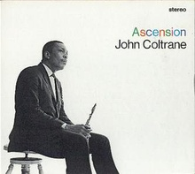 "In a black-and-white photo, Coltrane sits on a stool facing right, wearing a three-piece suit and holding his saxophone between his legs. To the right, the word ""stereo"" appears in the upper corner in black, with ""Ascension"" written in multiple colors beneath it, followed by ""John Coltrane"" in black below that."