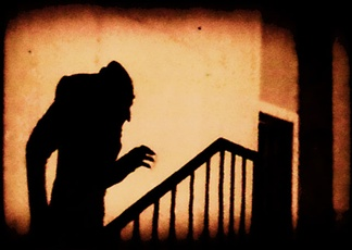 A famous scene from the 1922 German horror film Nosferatu