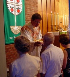 LCMS pastor wearing a chasuble during communion