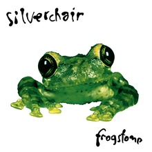 "A photo of a green frog in front of a white background, with ""Silverchair"" written above and ""Frogstomp"" written below it in a handwritten-style font."