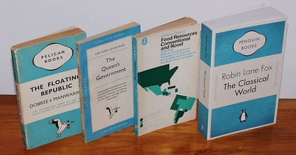 "Four Pelican book covers, showing the gradual shift in the design. From left - 1937 (three bands), 1955 (grid), 1969 (illustrated), and 2007 (a ""Penguin Celebrations"" throwback edition)"